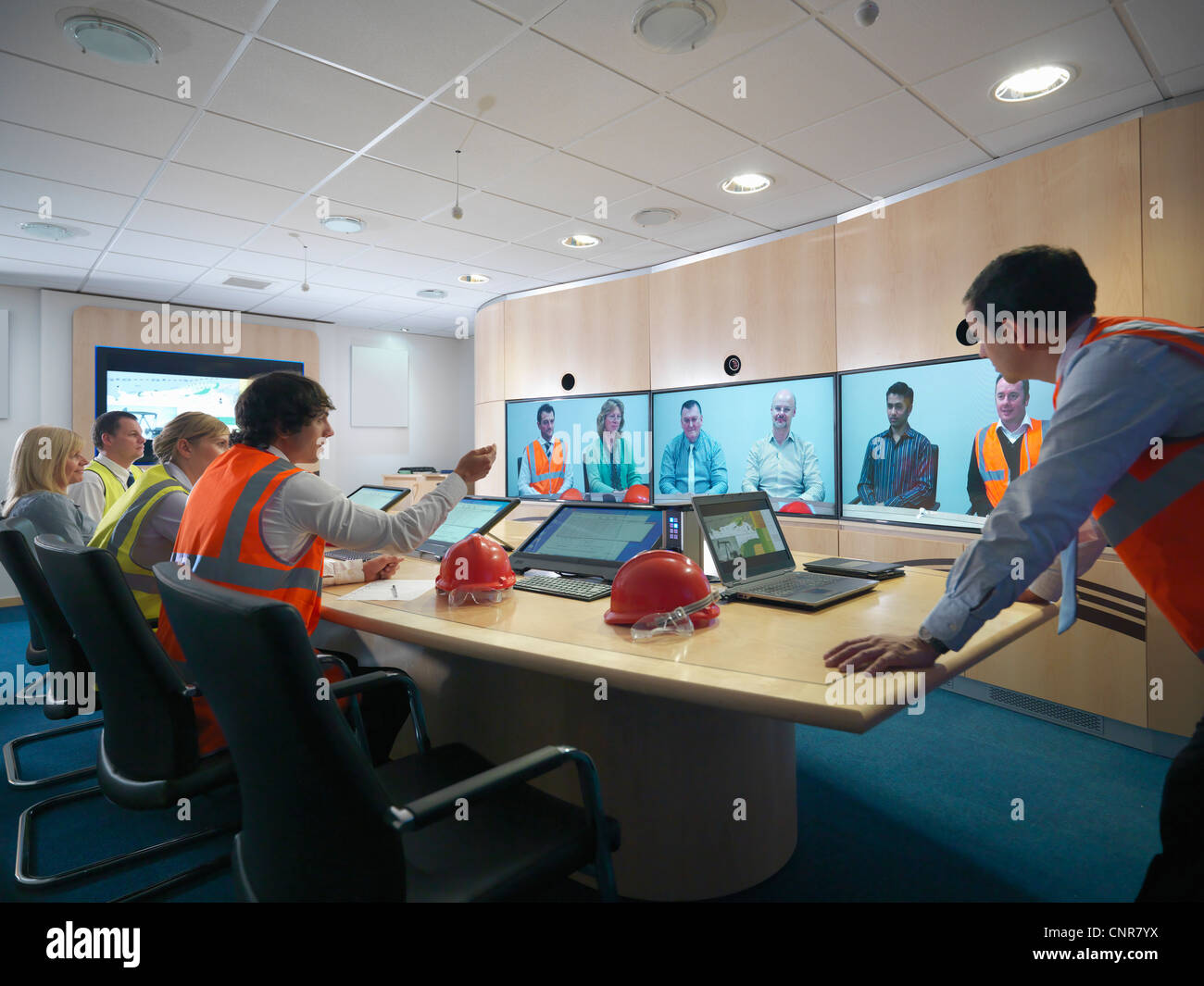 Construction workers in video conference - Stock Image