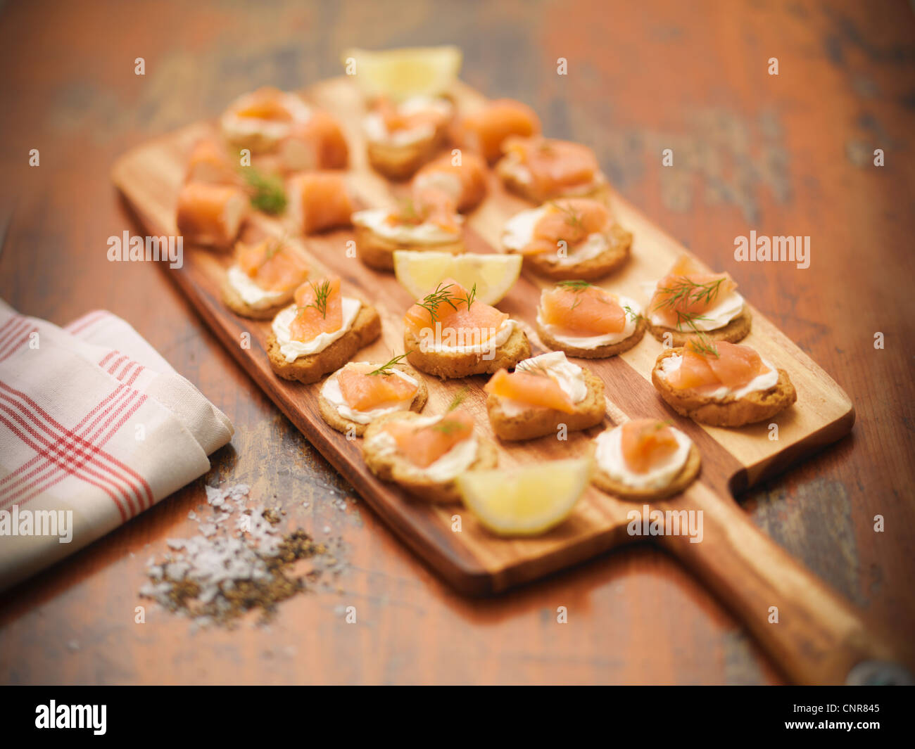 Plate of salmon, cheese and crackers - Stock Image