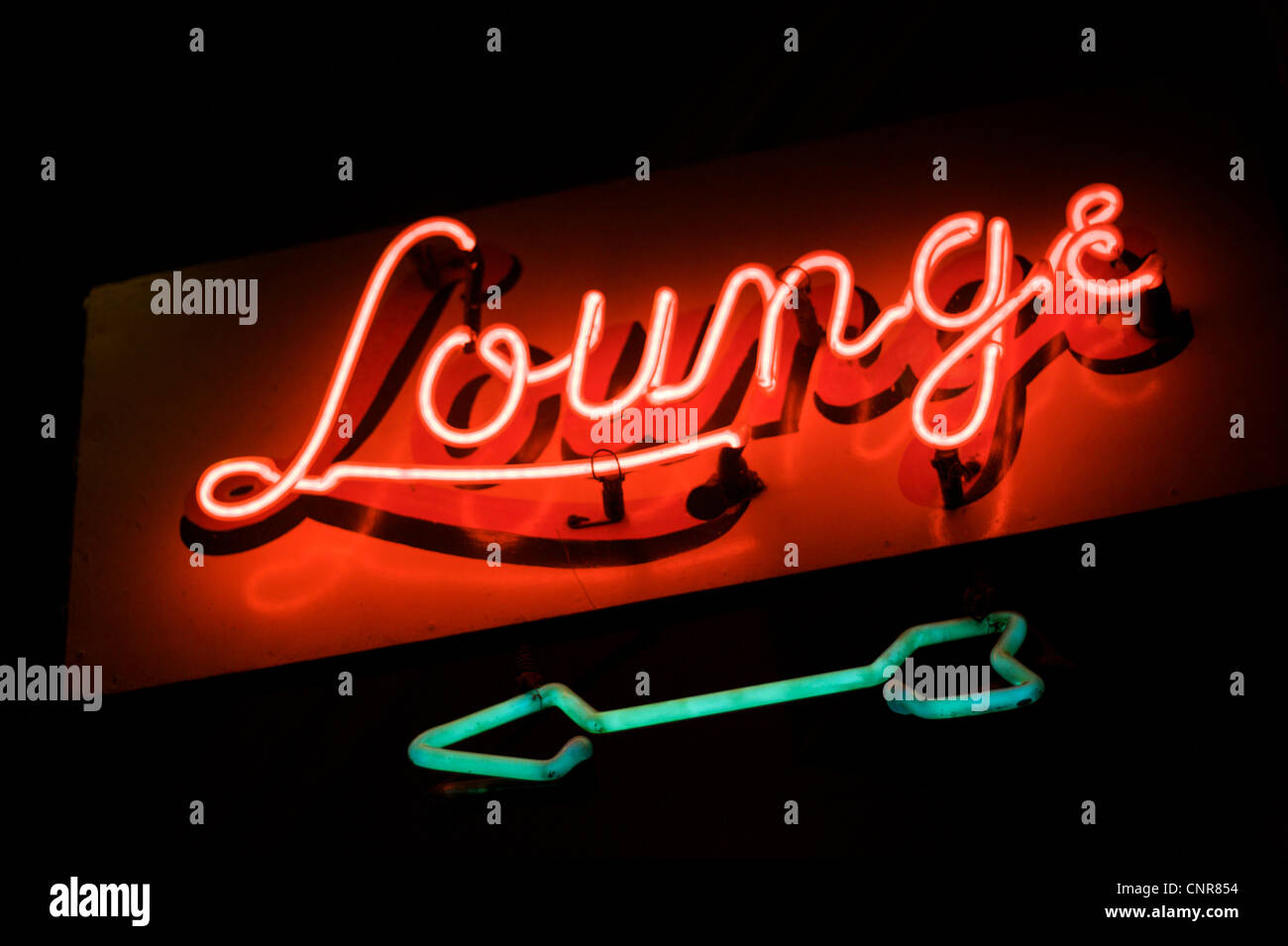 Neon sign reading Lounge - Stock Image