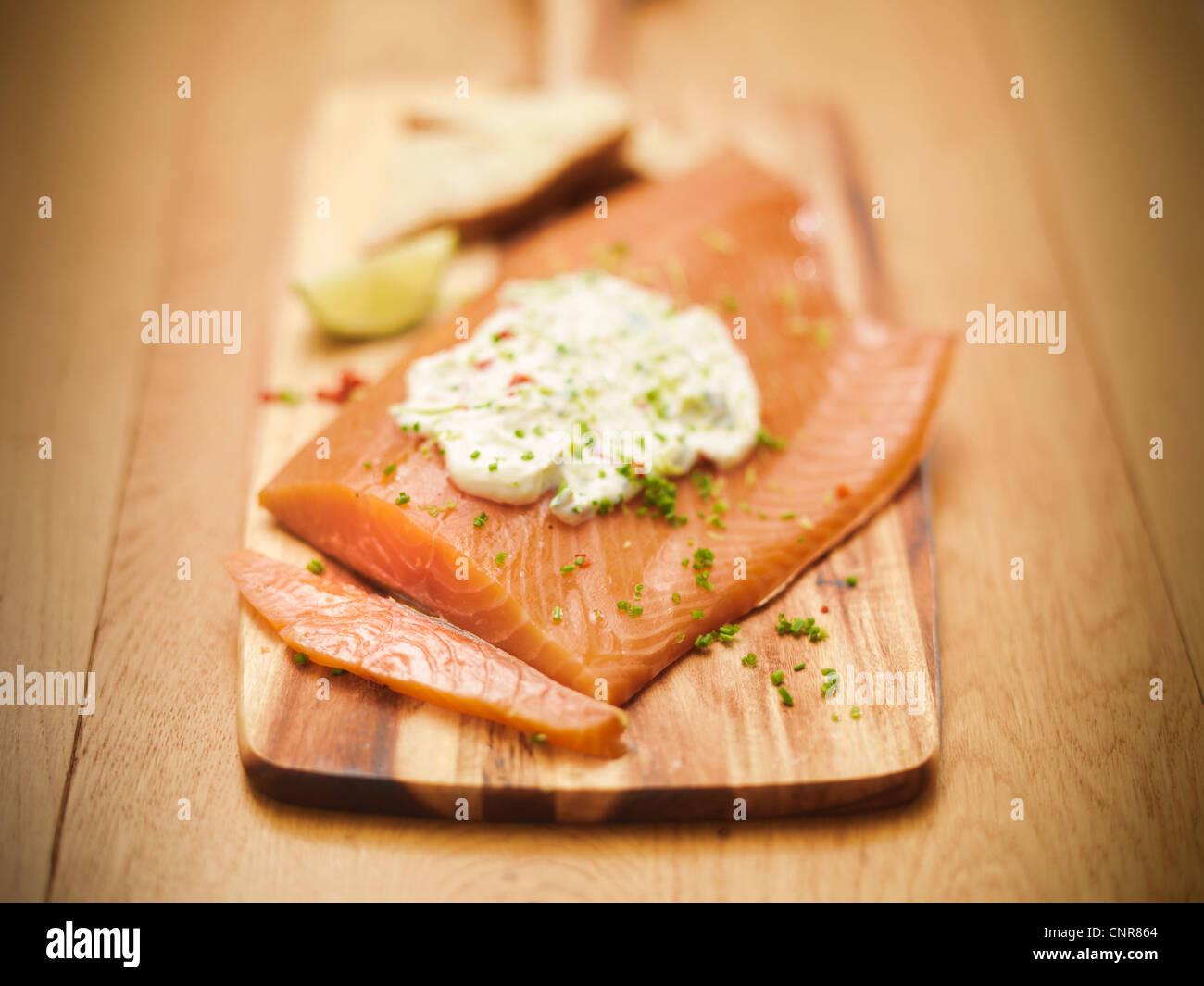 Plate of salmon with tartar sauce - Stock Image