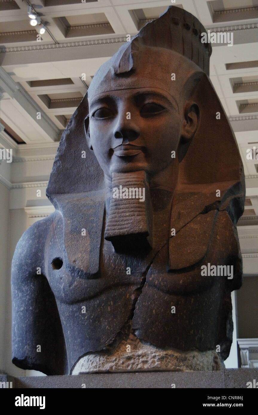 Egypt. Colossal statue of Ramesses II, the Younger Memnon. C. 1250 BC. 19th Dynasty. New Kingdom. Granite. Stock Photo
