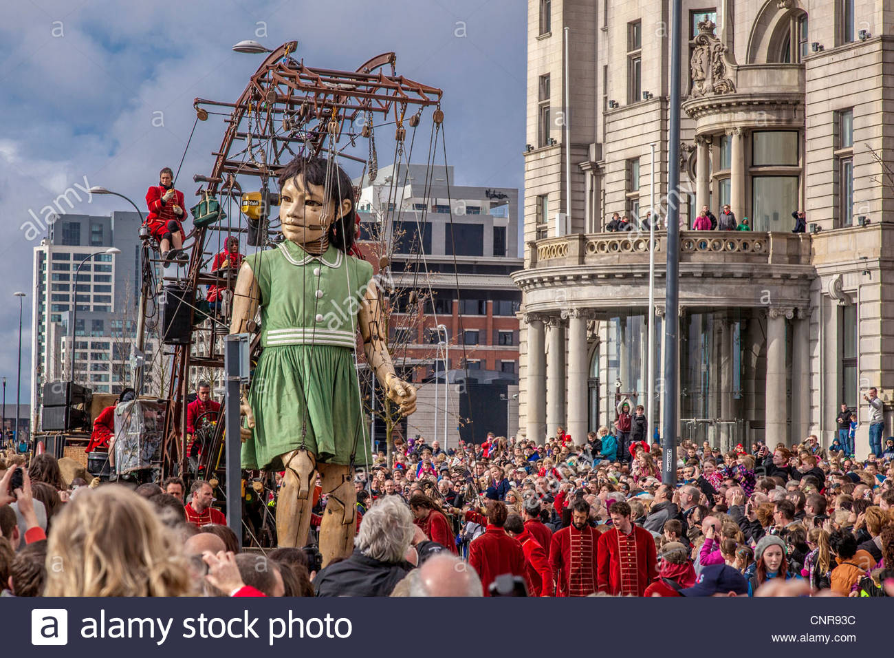 Street theatre company Royal De Luxe Giants marionette show called Sea Odyssey seen in front of the Liver building. - Stock Image