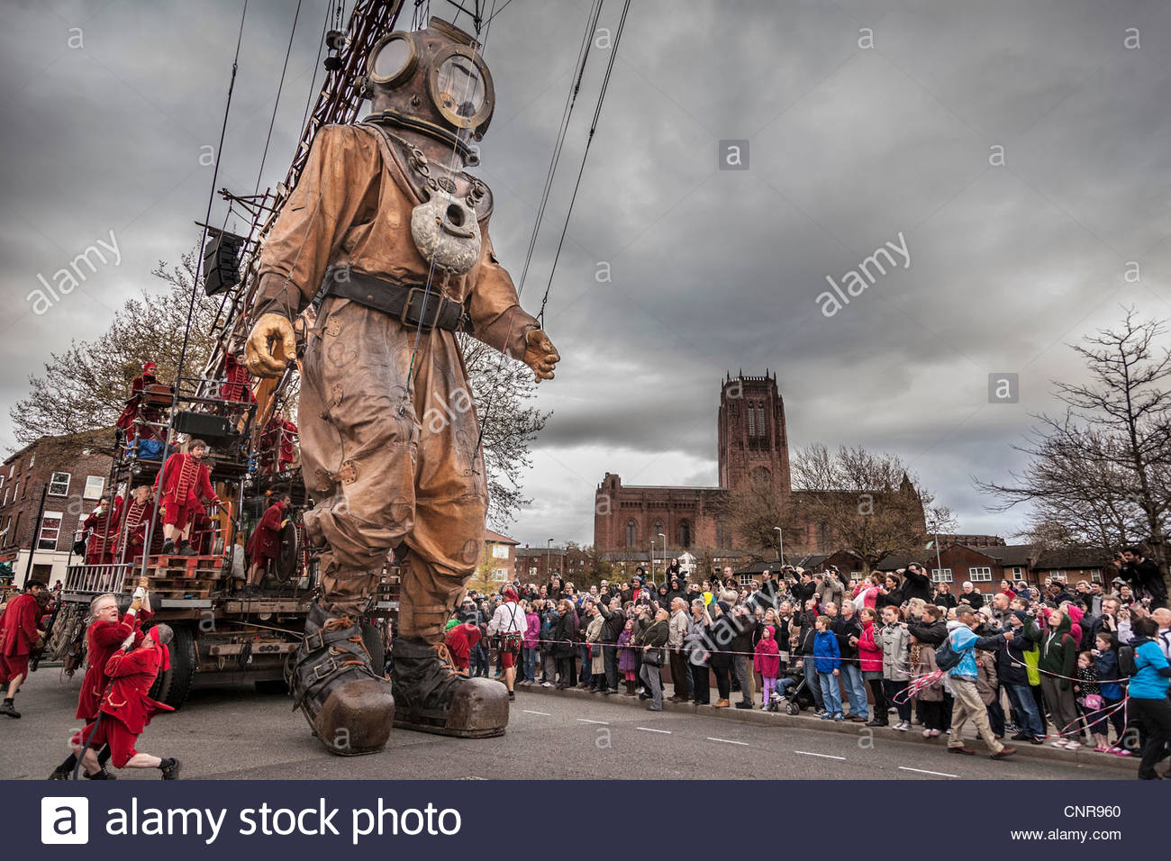 Street theatre company Royal De Luxe Giants marionette show called Sea Odyssey seen in front of the Anglican cathedral - Stock Image