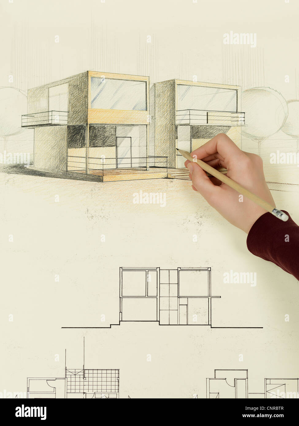Womans hand drawing architectural perspective of modern house