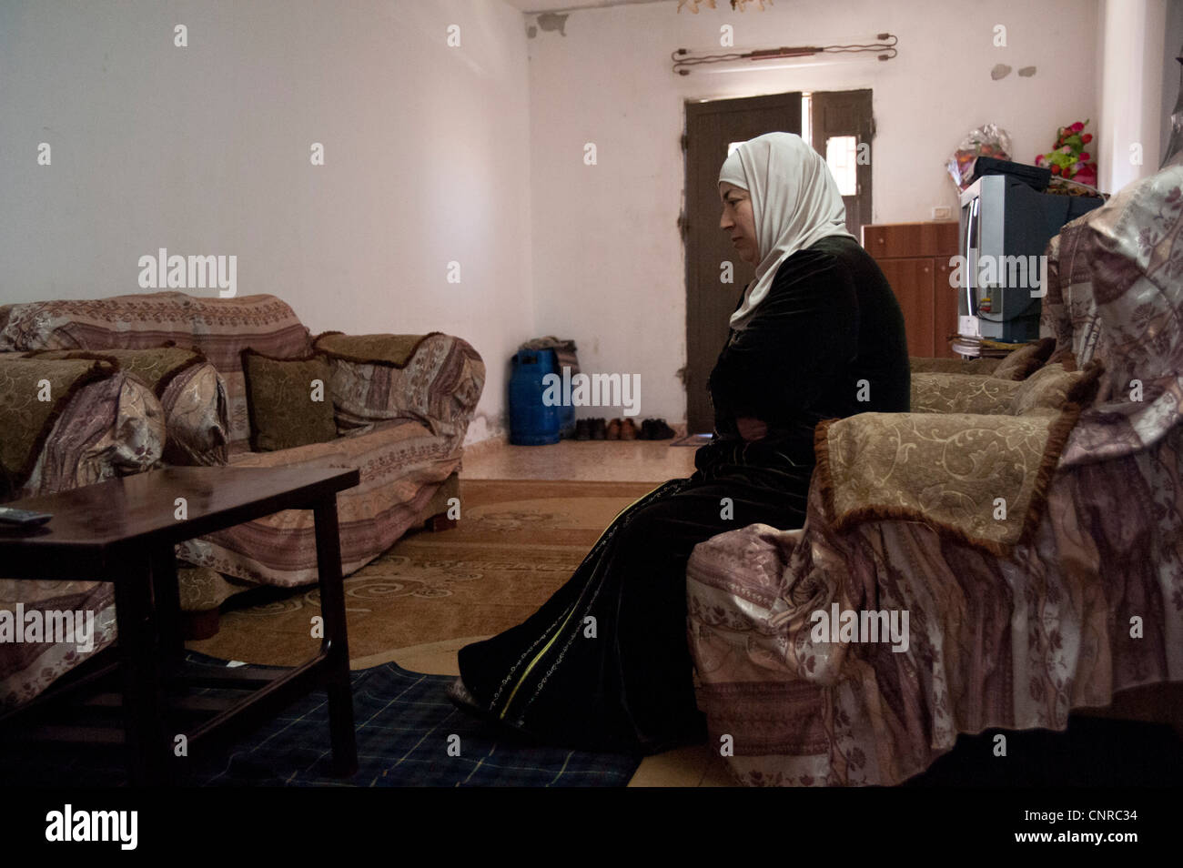 Palestinian villages under repression., A traumatized lady - Stock Image