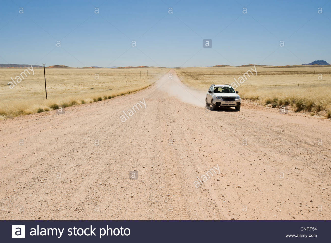 Desolate road through Namib Desert, Namibia - Stock Image