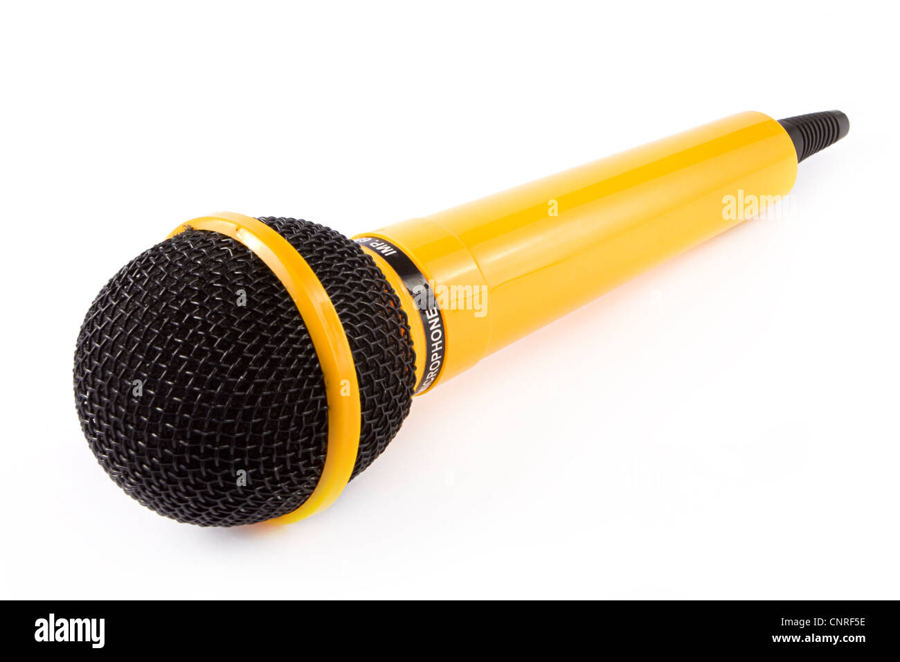 Yellow microphone on a white background - Stock Image