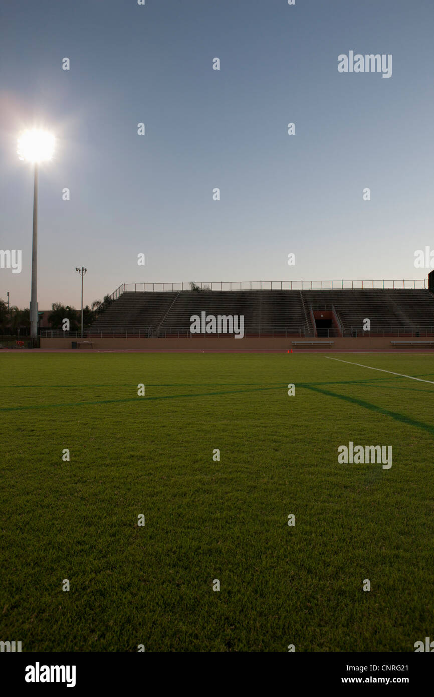 Empty sports field and stadium - Stock Image