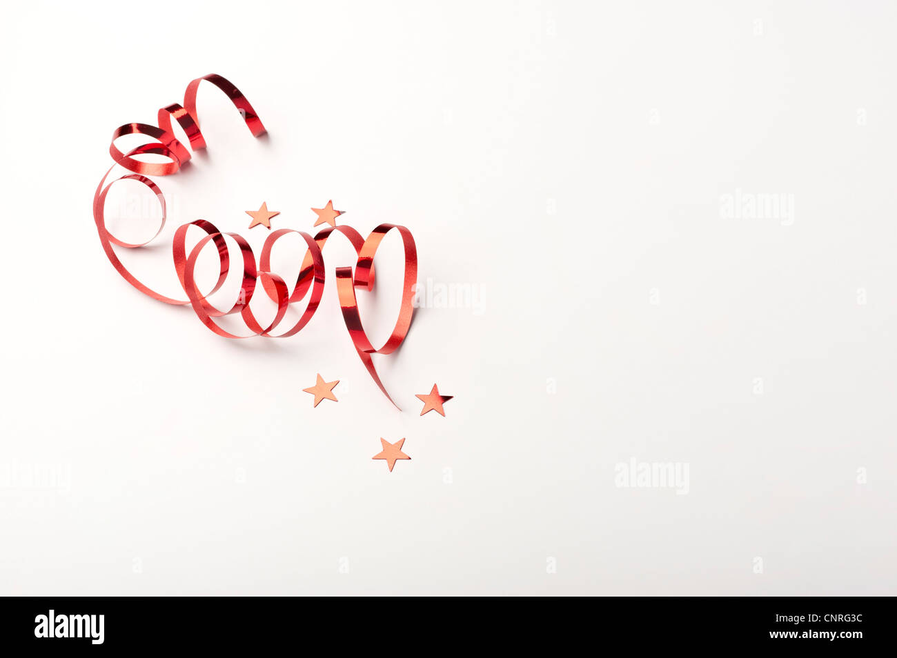 Confetti and gift-wrap ribbon - Stock Image