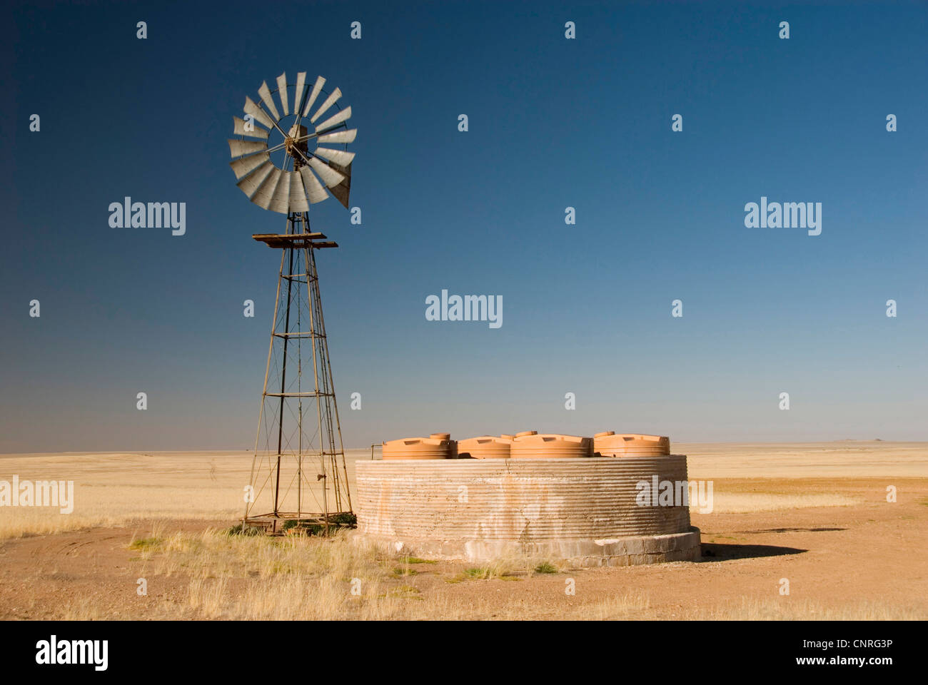 wind wheel for water supply; Zebra Pan, Namibia, Namib-Naukluft-Park - Stock Image