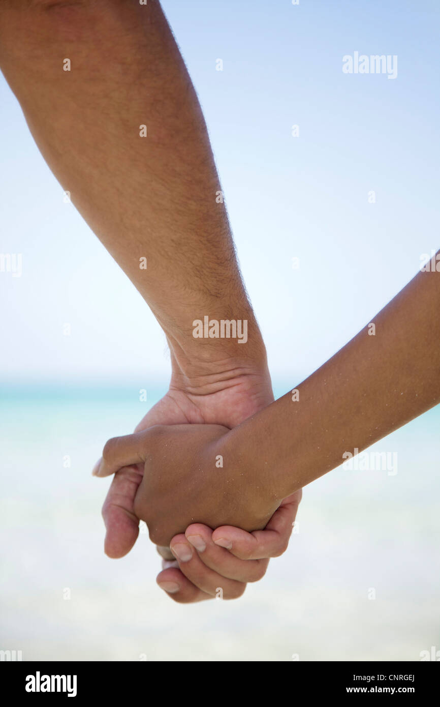 Couple holding hands, cropped - Stock Image