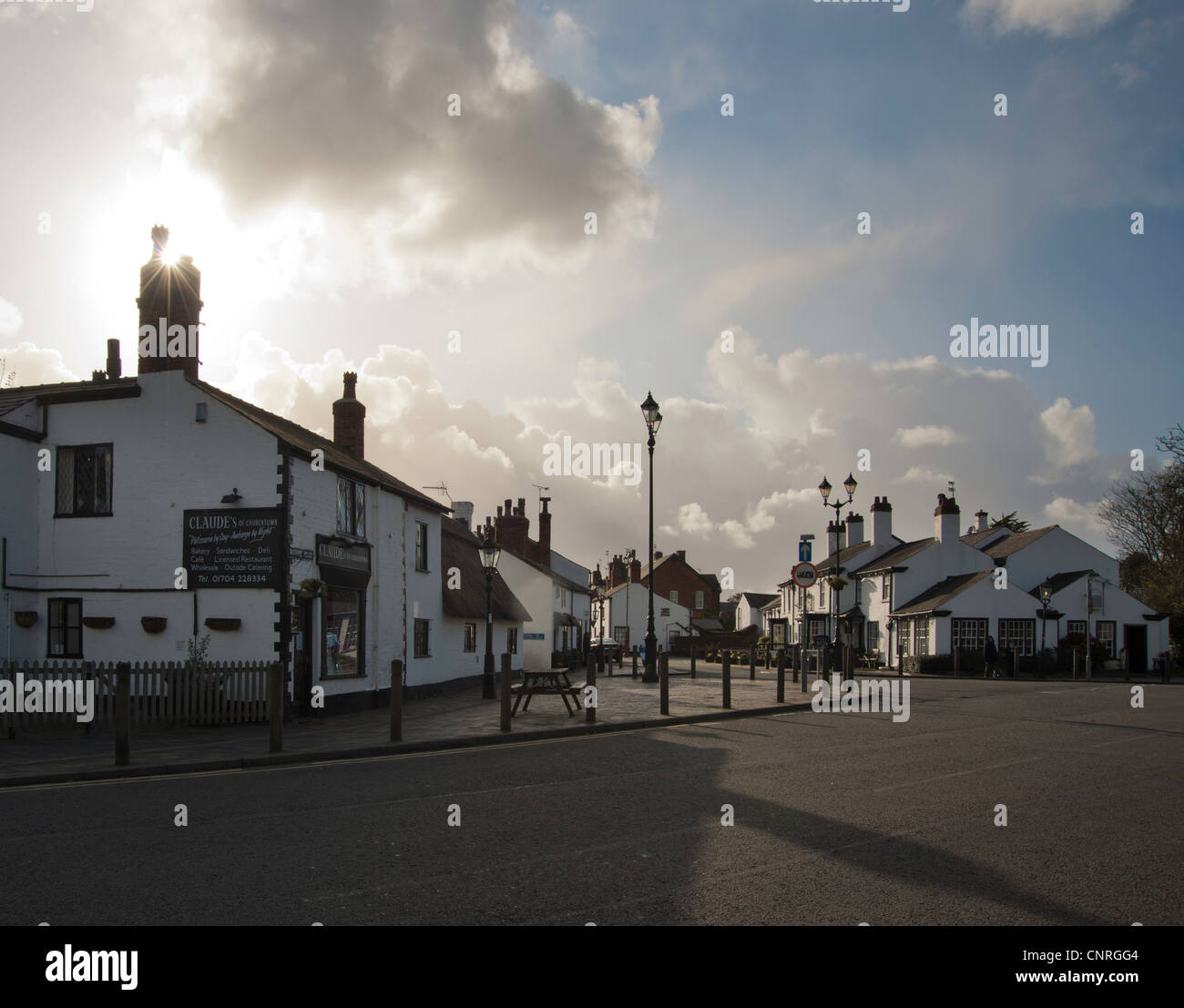 Traditional English village street with pub. - Stock Image