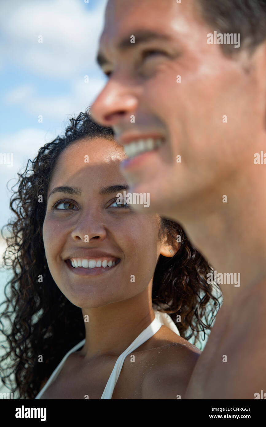 Couple together outdoors, woman smiling at man - Stock Image