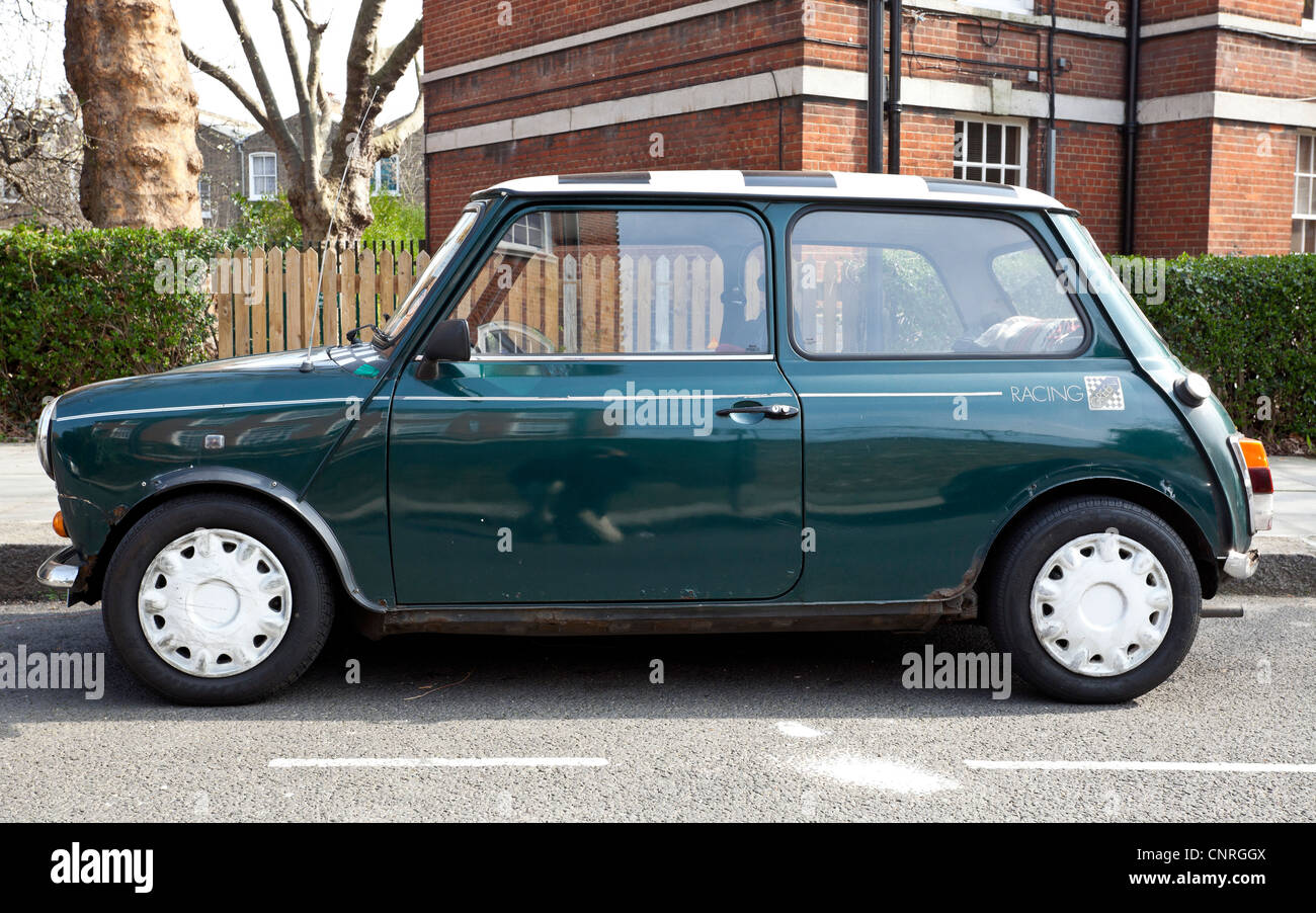 Side view of an old Mini Cooper parked at roadside, London, England, UK - Stock Image