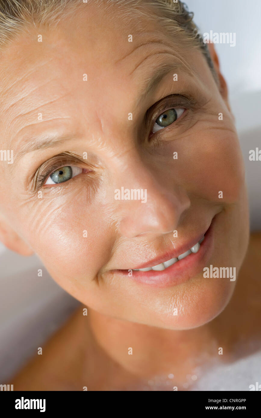 Mature woman in bath, cropped - Stock Image