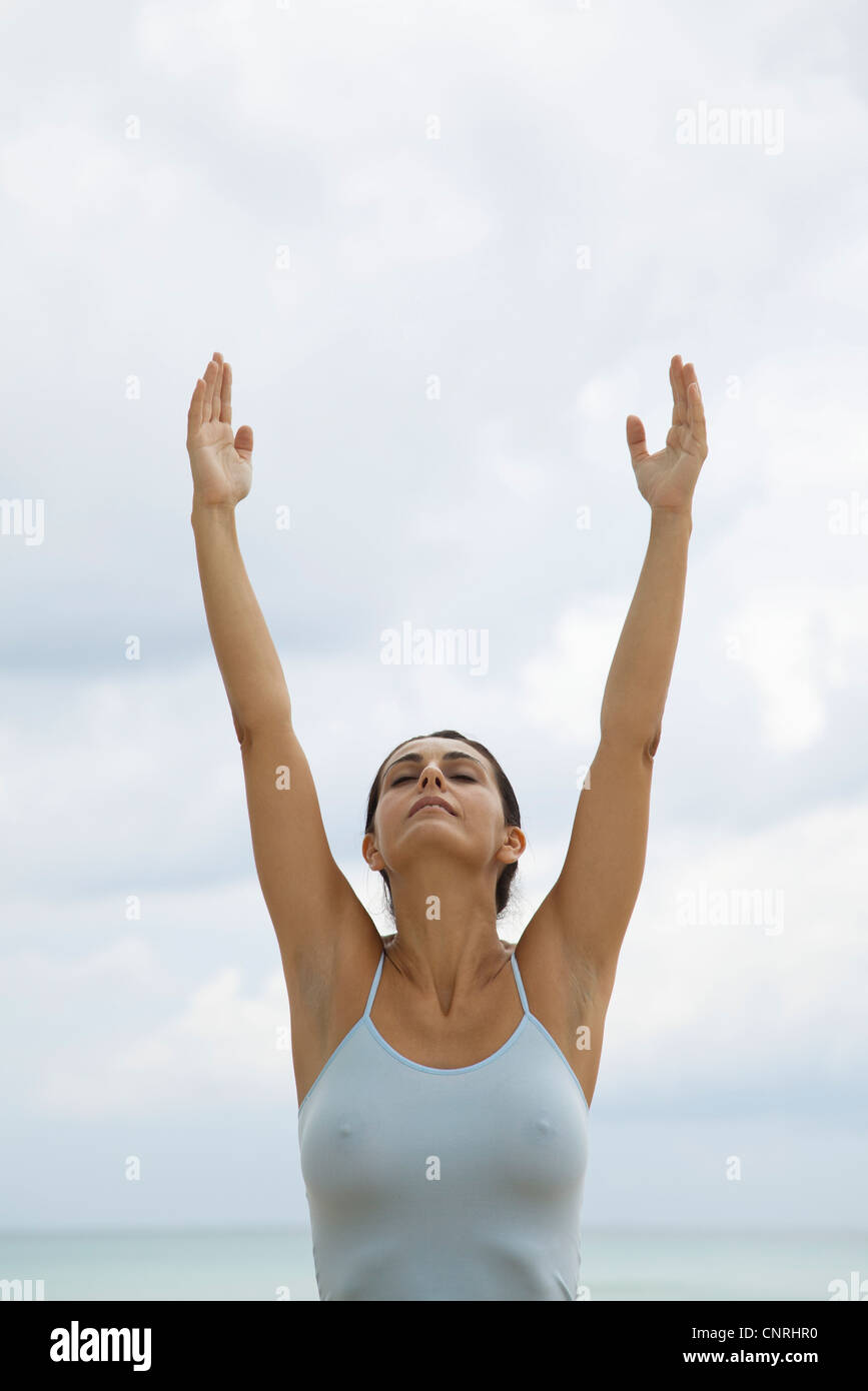 Mature woman in upward salute position - Stock Image