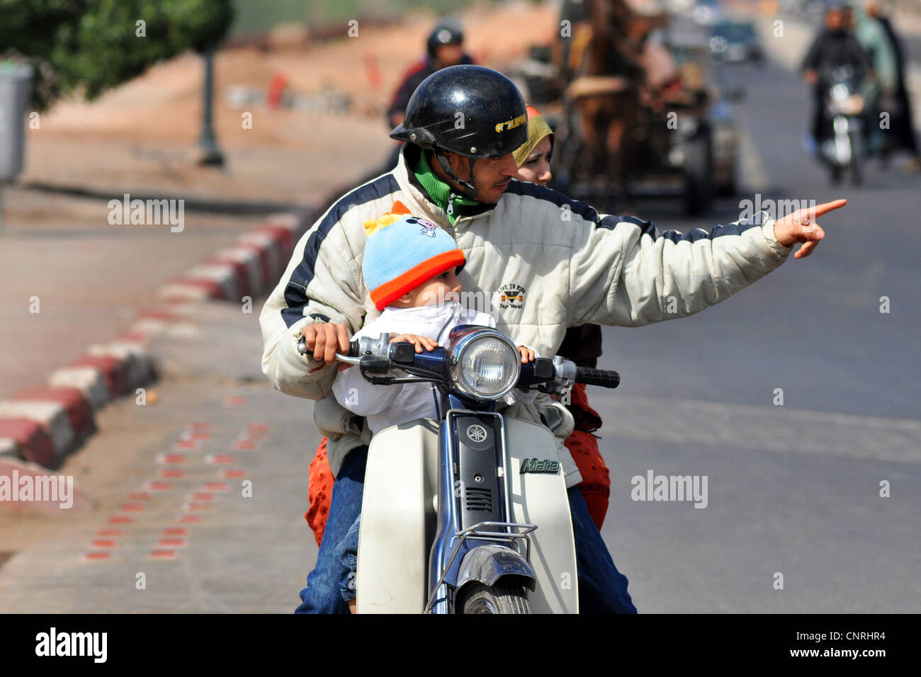 Whole Family on a motorbike, Marrakesh, Morocco - Stock Image