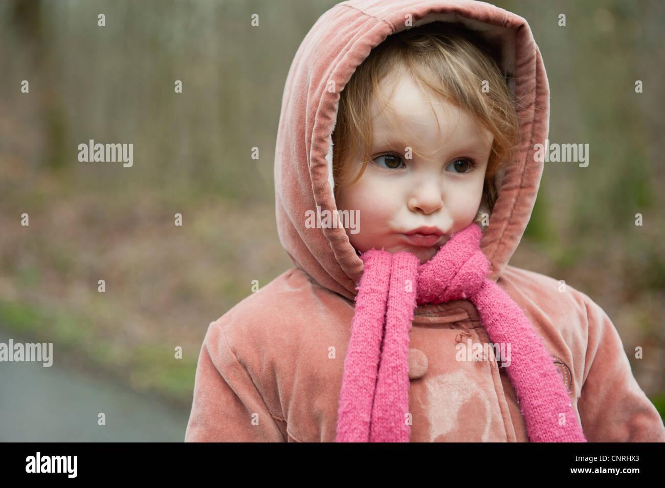 Little girl making face, portrait - Stock Image