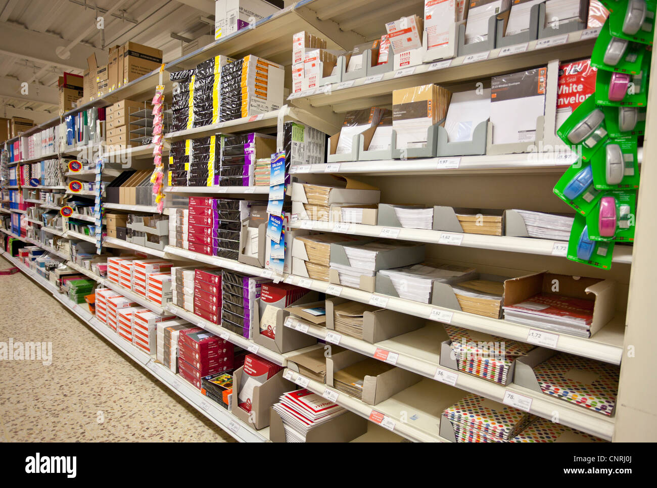 Stationary shelves in an aisle of a shop, London, England, UK - Stock Image