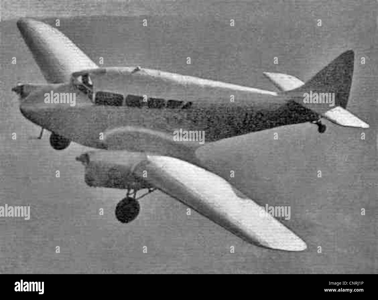 Miles Peregrine in flight with retractable undercarriage lowered - Stock Image