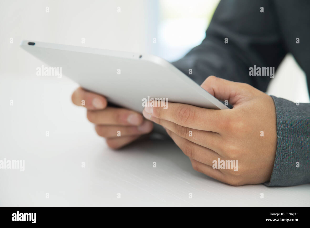 Man using digital tablet, cropped - Stock Image