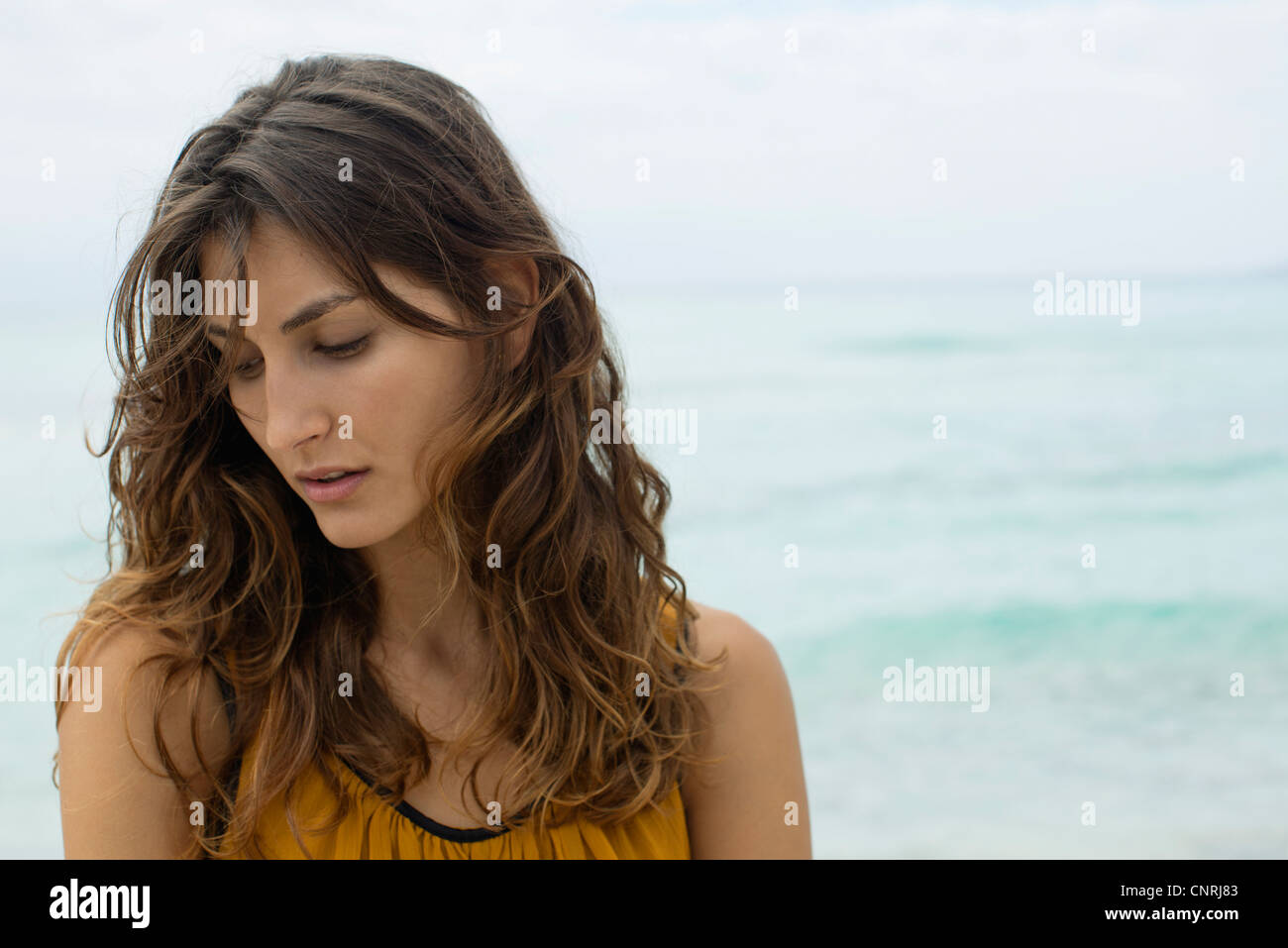 Young woman looking down - Stock Image