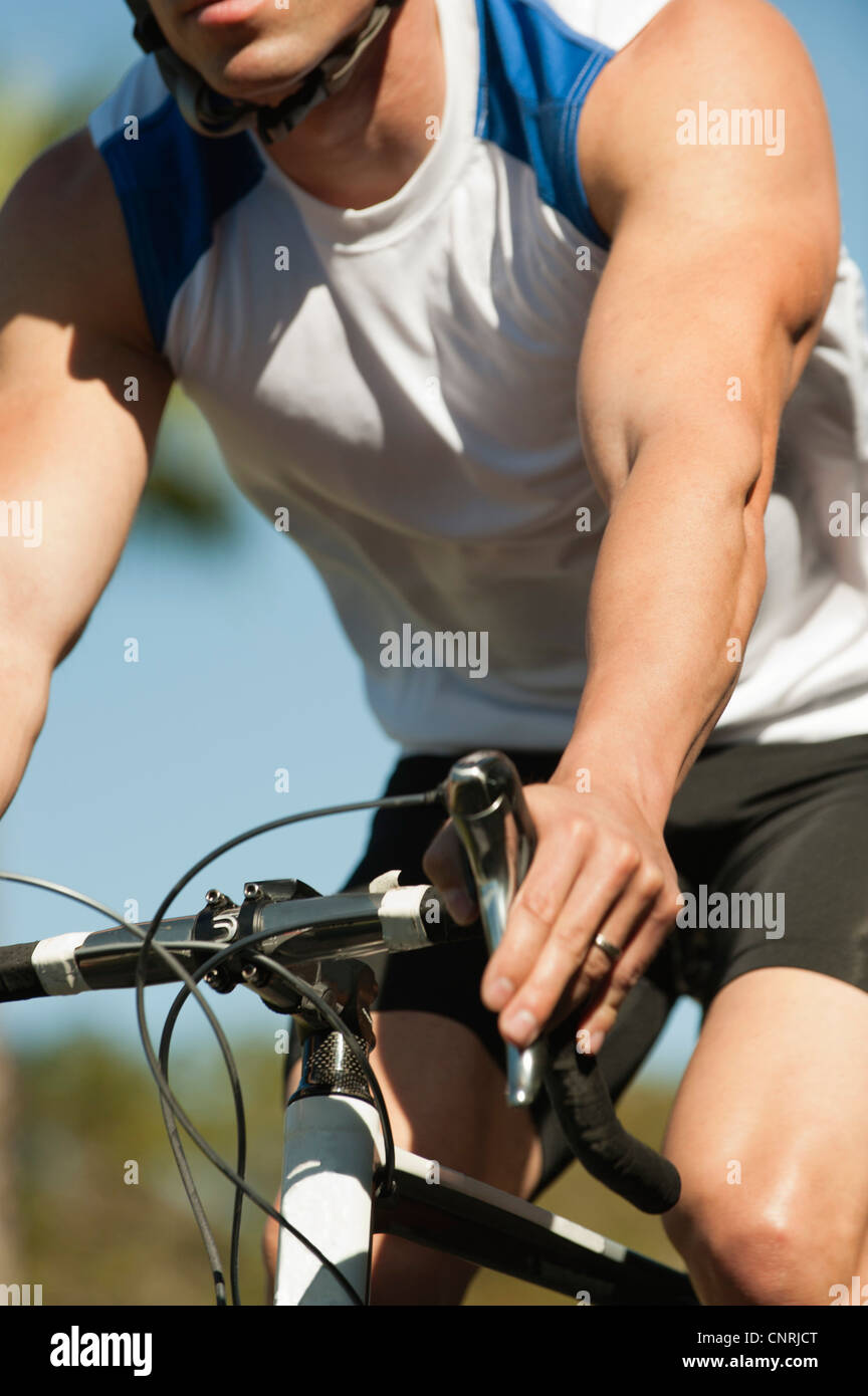 Man riding bicycle, mid section - Stock Image