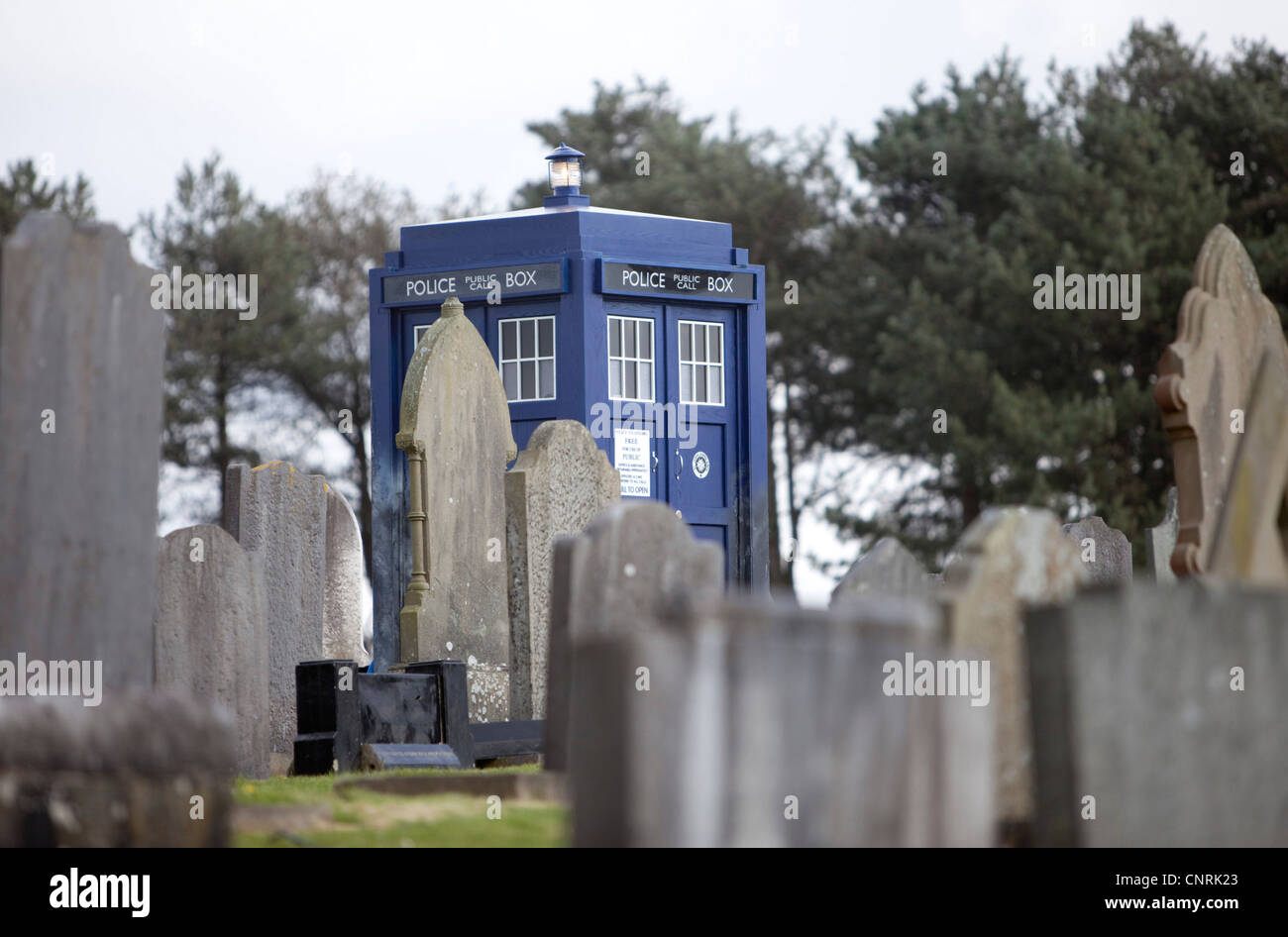The Tardis, on set for the filming of Doctor Who at the Box Cemetery, Llanelli Carmarthenshire. - Stock Image