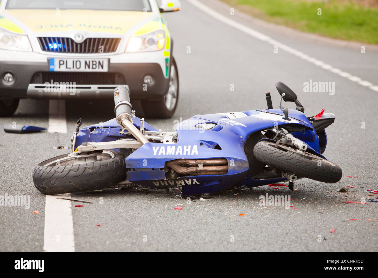 A crash on the A66 near Penrith, Cumbria, UK, involving a car and a motorbike. - Stock Image