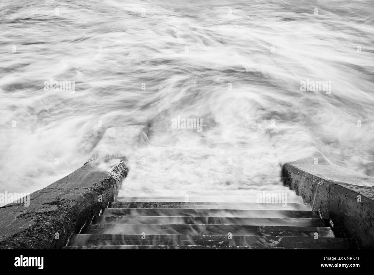 Swirling waves at Scarborough's North Bay, North Yorkshire. - Stock Image