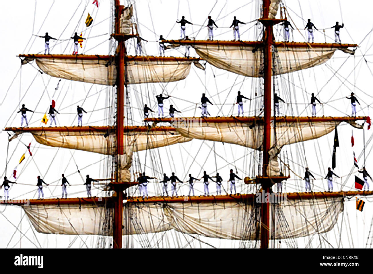 Ecuadorian sailors of the Ecuadorian tall ship BAE Guayas man the yardarms as they arrive in New Orleans for the - Stock Image