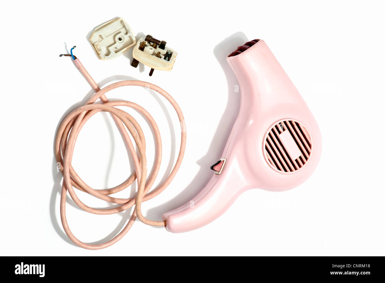 A pink hairdryer with the plug taken apart - Stock Image