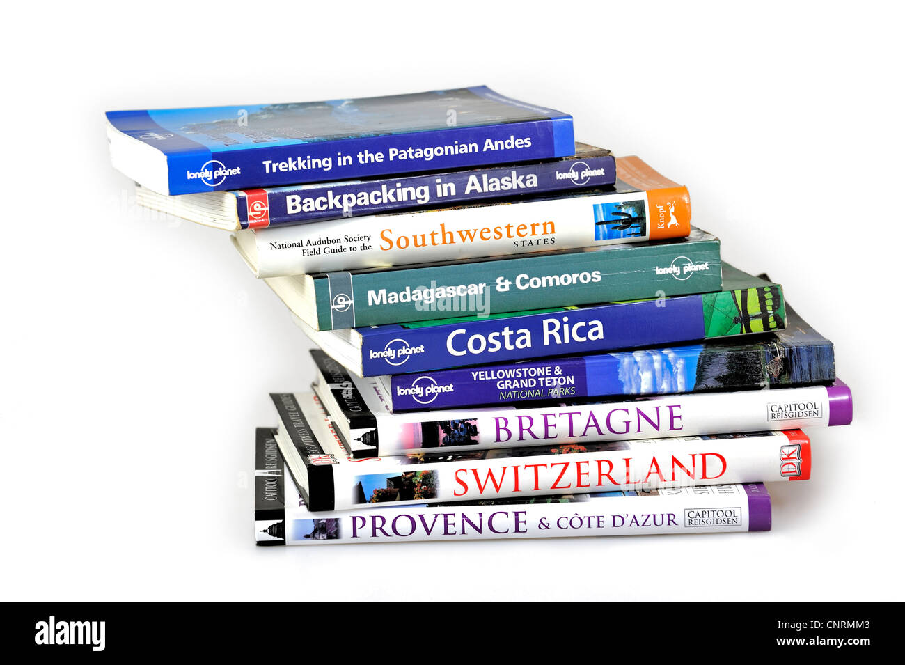 Collection showing assortment of travel guides and guidebooks about worldwide holiday destinations - Stock Image