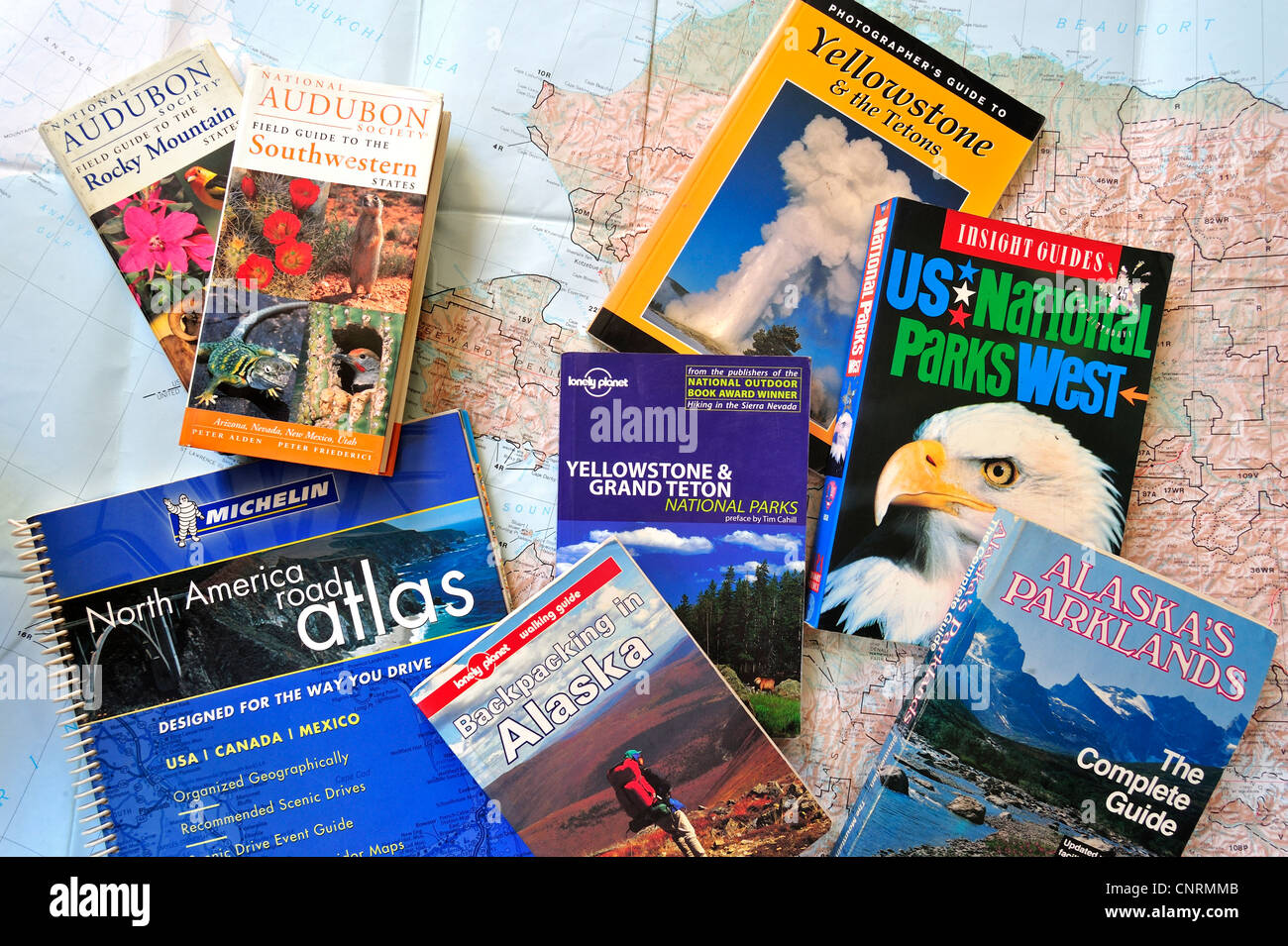 Road map and assortment of travel guides and guidebooks about North American national parks to plan backpacking - Stock Image