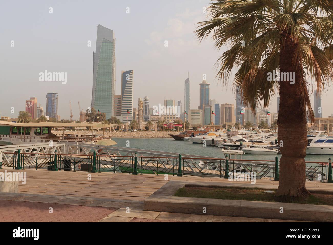 View of Kuwait City skyline across Souq Sharq Marina - Stock Image