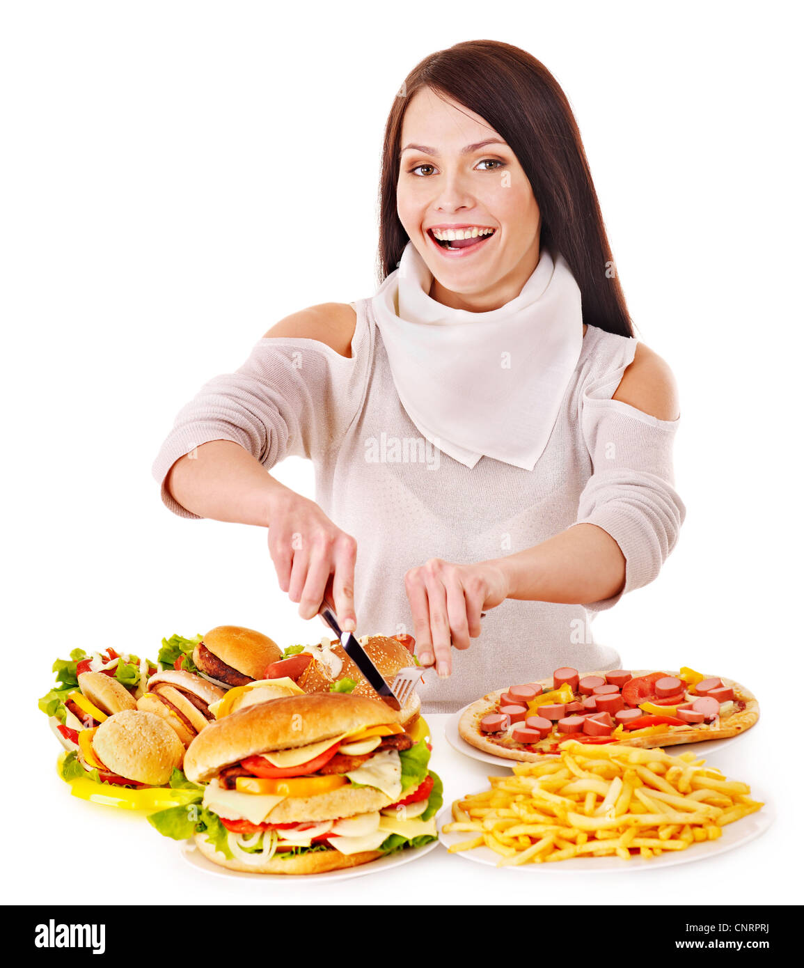 Woman eating fast food. Isolated. - Stock Image