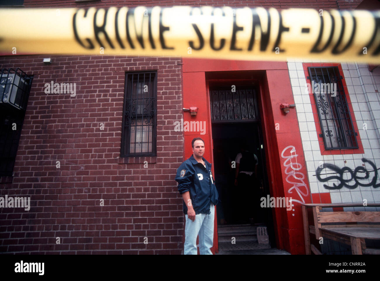 An NYPD officer guards a crime scene in Chinatown on August 28, 1993 - Stock Image