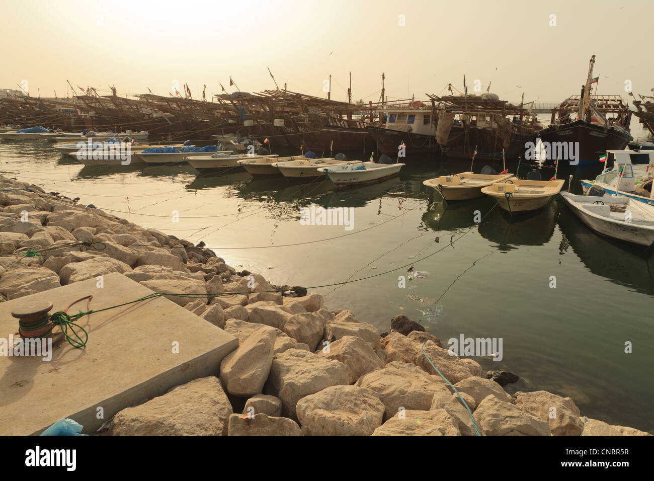 Fishing boats and Dhows in Kuwait City moored up next to the Fish Market - Stock Image