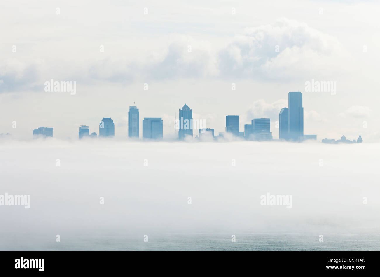 Fog bank over downtown Seattle, Washington USA - Stock Image