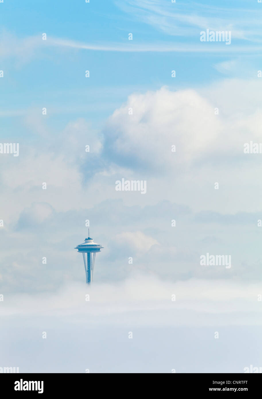 A fog bank obscures downtown Seattle and the Space Needle sticks up through the fog, Washington USA - Stock Image