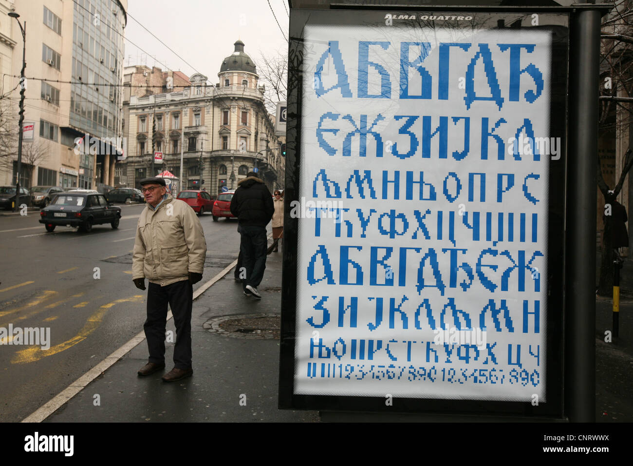 Poster supported the Cyrillic alphabet on a bus stop in Belgrade, Serbia. - Stock Image