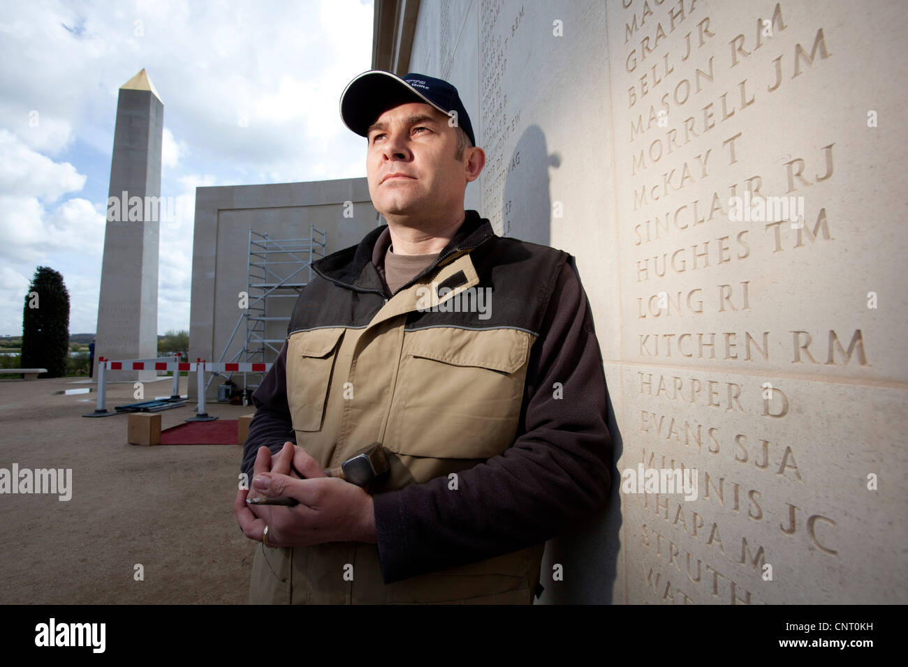 Engraver Nick Hindle starts to add the names of Service men and women who lost their lives in 2011 at the NMA, Alrewas, - Stock Image