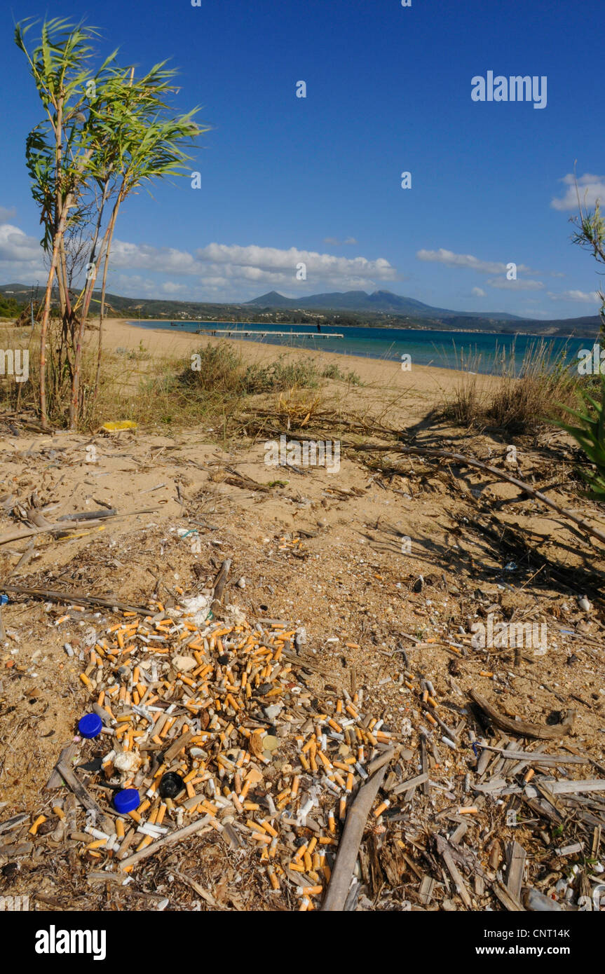cigarettes from an emptied ash tray on the beach, Greece, Peloponnes, Pylos Stock Photo