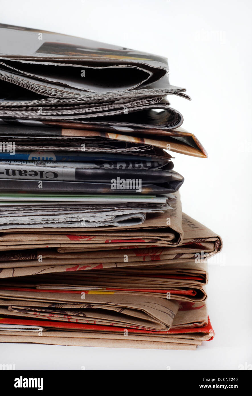 Stack of newspapers and bags - Stock Image