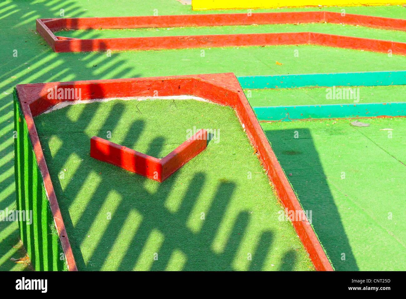 Crazy Golf, Gates, fences, holes, shadows - Stock Image
