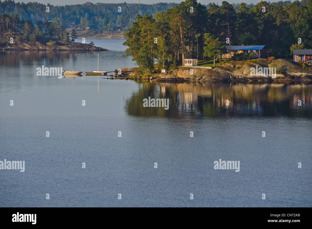Cottages and pleasure boats are common along the Baltic Sea amid the islands of the Stockholm Archipelago on the - Stock Image