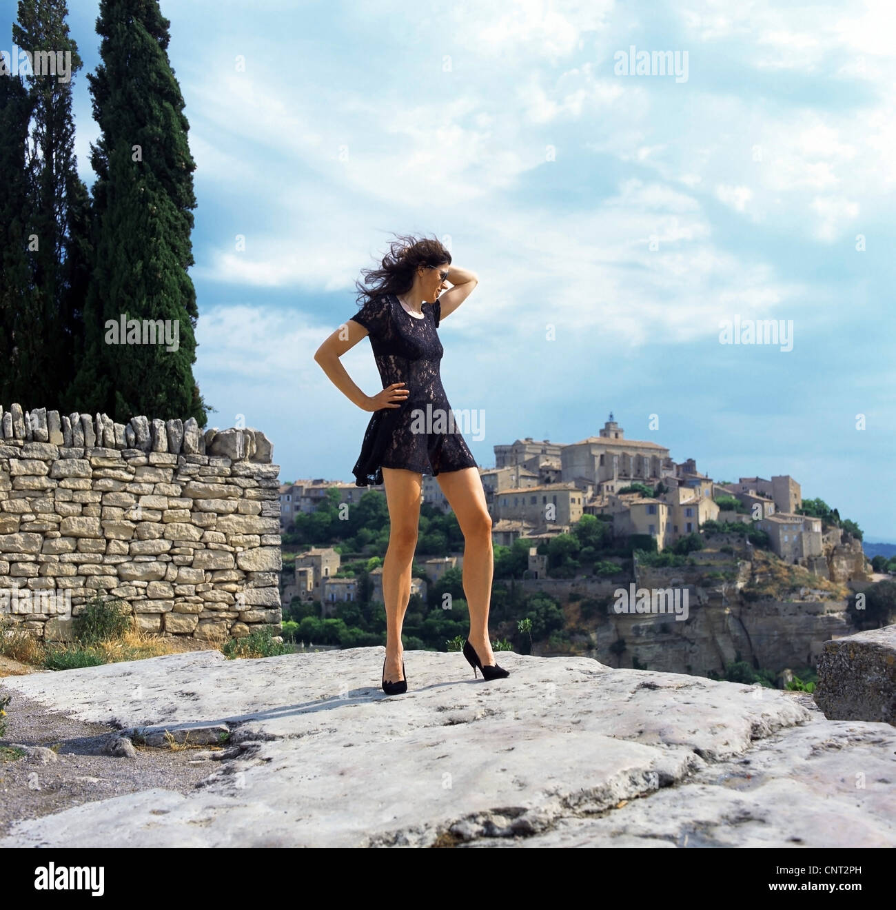 woman in minidress enjoying the view, France, Provence, Cordes - Stock Image
