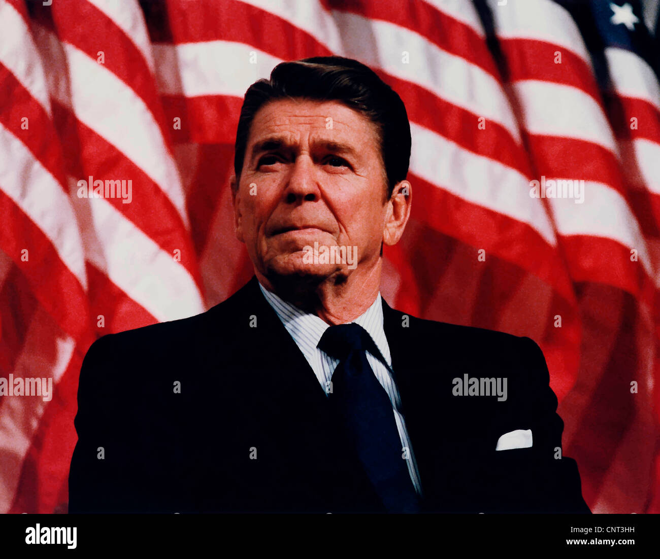 Digitally restored vector photo of President Ronald Reagan speaking in front of American Flags. - Stock Image