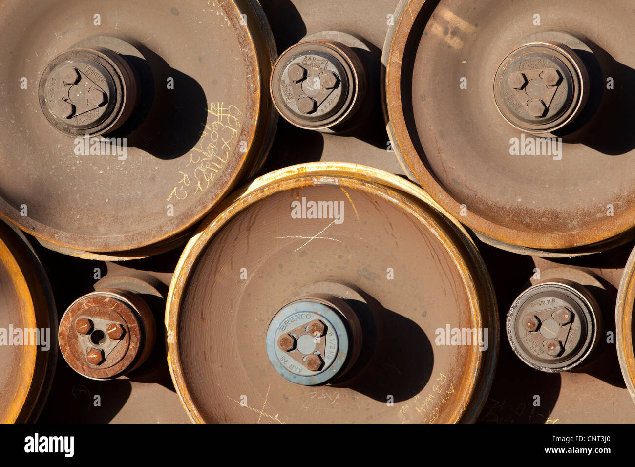 Stacked railroad car wheels - Stock Image