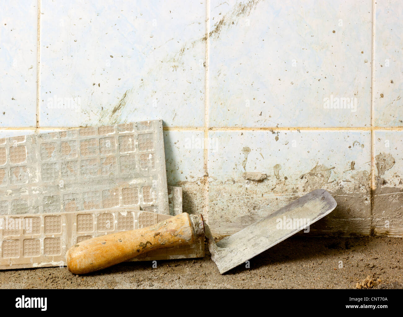 Section of a house renovation showing unfinished flooring - Stock Image